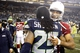 Dec 22, 2013; Seattle, WA, USA; Arizona Cardinals wide receiver Larry Fitzgerald (11) hugs Seattle Seahawks cornerback Richard Sherman (25) following a 17-10 Arizona victory at CenturyLink Field. Mandatory Credit: Joe Nicholson-USA TODAY Sports