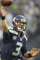 Dec 22, 2013; Seattle, WA, USA; Seattle Seahawks quarterback Russell Wilson (3) passes against the Arizona Cardinals during the fourth quarter at CenturyLink Field. Mandatory Credit: Joe Nicholson-USA TODAY Sports