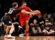 Dec 25, 2013; Brooklyn, NY, USA;  Brooklyn Nets power forward Mirza Teletovic (33) defends Chicago Bulls center Joakim Noah (13) during the third quarter at Barclays Center. Chicago Bulls won 95-78.  Mandatory Credit: Anthony Gruppuso-USA TODAY Sports