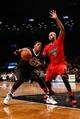 Dec 25, 2013; Brooklyn, NY, USA;  Chicago Bulls power forward Taj Gibson (22) defends Brooklyn Nets small forward Paul Pierce (34) during the fourth quarter at Barclays Center. Chicago Bulls won 95-78.  Mandatory Credit: Anthony Gruppuso-USA TODAY Sports