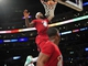December 25, 2013; Los Angeles, CA, USA; Miami Heat small forward LeBron James (6) dunks to score a basket, recieving the assist from shooting guard Dwyane Wade (3) against the Los Angeles Lakers during the first half at Staples Center. Mandatory Credit: Gary A. Vasquez-USA TODAY Sports