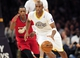 December 25, 2013; Los Angeles, CA, USA; Los Angeles Lakers shooting guard Jodie Meeks (20) moves the ball ahead of Miami Heat point guard Mario Chalmers (15) during the second half at Staples Center. Mandatory Credit: Gary A. Vasquez-USA TODAY Sports