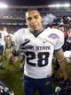 Dec 26, 2013; San Diego, CA, USA; Utah State Aggies running back Joey DeMartino (28) celebrates after the 2013 Poinsettia Bowl against the Northern Illinois Huskies at Qualcomm Stadium. Mandatory Credit: Kirby Lee-USA TODAY Sports