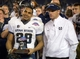 Dec 26, 2013; San Diego, CA, USA; Utah State Aggies running back Joey DeMartino (28) and coach Matt Wells celebrate after the 2013 Poinsettia Bowl against the Northern Illinois Huskies at Qualcomm Stadium. Mandatory Credit: Kirby Lee-USA TODAY Sports