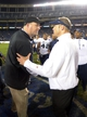 Dec 26, 2013; San Diego, CA, USA; Northern Illinois Huskies coach Rod Carey (left) and Utah State Aggies coach Matt Wells shake hands after the 2013 Poinsettia Bowl at Qualcomm Stadium. Mandatory Credit: Kirby Lee-USA TODAY Sports