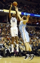 Dec 28, 2013; Memphis, TN, USA; Memphis Grizzlies power forward Ed Davis (32) shoots over Denver Nuggets center Timofey Mozgov (25) during the second quarter at FedExForum. Mandatory Credit: Justin Ford-USA TODAY Sports
