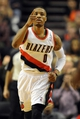 Dec 28, 2013; Portland, OR, USA; Portland Trail Blazers point guard Damian Lillard (0) signals to a teammate during the first quarter of the game against the Miami Heat at the Moda Center. Mandatory Credit: Steve Dykes-USA TODAY Sports
