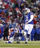 Dec 22, 2013; Orchard Park, NY, USA; Buffalo Bills kicker Dan Carpenter (2) kicks a field goal as punter Brian Moorman (8) holds during the second half against the Miami Dolphins at Ralph Wilson Stadium. Bills beat the Dolphins 19-0. Mandatory Credit: Kevin Hoffman-USA TODAY Sports