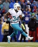 Dec 22, 2013; Orchard Park, NY, USA; Miami Dolphins running back Marcus Thigpen (34) during the second half against the Buffalo Bills at Ralph Wilson Stadium. Mandatory Credit: Kevin Hoffman-USA TODAY Sports