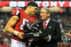 Dec 29, 2013; Atlanta, GA, USA; Atlanta Falcons tight end Tony Gonzalez (88) is honored by owner Arthur Blank during halftime against the Carolina Panthers at the Georgia Dome. Mandatory Credit: Daniel Shirey-USA TODAY Sports