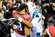 Dec 29, 2013; Atlanta, GA, USA; Carolina Panthers quarterback Cam Newton (1) hugs Atlanta Falcons tight end Tony Gonzalez (88) after the game at the Georgia Dome. The Panthers won 21-20. Mandatory Credit: Dale Zanine-USA TODAY Sports