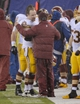 Dec 29, 2013; East Rutherford, NJ, USA; Washington Redskins head coach Mike Shanahan gets a hug from center Will Montgomery (63) in the closing moments of the game against the New York Giants at MetLife Stadium. Mandatory Credit: Robert Deutsch-USA TODAY Sports
