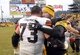 Dec 29, 2013; Pittsburgh, PA, USA; Cleveland Browns tackle Joe Thomas (73) and Pittsburgh Steelers quarterback Ben Roethlisberger (right) embrace after playing at Heinz Field. The Pittsburgh Steelers won 20-7. Mandatory Credit: Charles LeClaire-USA TODAY Sports
