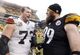 Dec 29, 2013; Pittsburgh, PA, USA; Cleveland Browns tackle Joe Thomas (73) and Pittsburgh Steelers defensive end Brett Keisel (99) meet at mid-field after playing at Heinz Field. The Pittsburgh Steelers won 20-7. Mandatory Credit: Charles LeClaire-USA TODAY Sports