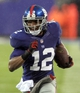 Dec 29, 2013; East Rutherford, NJ, USA; New York Giants wide receiver Jerrel Jernigan (12) runs for a touchdown against the Washington Redskins during the third quarter of a game at MetLife Stadium. The Giants defeated the Redskins 20-6. Mandatory Credit: Brad Penner-USA TODAY Sports