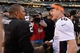 December 29, 2013; Oakland, CA, USA; Denver Broncos quarterback Peyton Manning (18) shakes hands with Oakland Raiders quarterback Terrelle Pryor (2) after the game at O.co Coliseum. The Broncos defeated the Raiders 34-14. Mandatory Credit: Kyle Terada-USA TODAY Sports