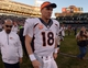Dec 29, 2013; Oakland, CA, USA; Denver Broncos quarterback Peyton Manning (18) walks off the field after setting the NFL single season passing yardage record against the Oakland Raiders at O.co Coliseum. The Broncos won 34-14. Mandatory Credit: Kirby Lee-USA TODAY Sports