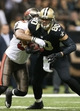 Dec 29, 2013; New Orleans, LA, USA; New Orleans Saints tight end Jimmy Graham (80) is tackled by Tampa Bay Buccaneers linebacker Ka'Lial Glaud (58) in the second half at the Mercedes-Benz Superdome. New Orleans defeated Tampa Bay 42-17. Mandatory Credit: Crystal LoGiudice-USA TODAY Sports