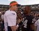 Dec 29, 2013; Oakland, CA, USA; Denver Broncos quarterback Peyton Manning (18) shakes hands with Oakland Raiders safety Charles Woodson (24) after their game at O.co Coliseum. The Broncos won 34-14. Mandatory Credit: Kirby Lee-USA TODAY Sports