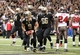 Dec 29, 2013; New Orleans, LA, USA; New Orleans Saints quarterback Drew Brees (9) is congratulated by teammates after a touchdown against the Tampa Bay Buccaneers in the second half at the Mercedes-Benz Superdome. New Orleans defeated Tampa Bay 42-17. Mandatory Credit: Crystal LoGiudice-USA TODAY Sports