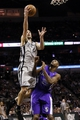 Dec 29, 2013; San Antonio, TX, USA; San Antonio Spurs guard Manu Ginobili (20) drives to the basket as Sacramento Kings forward Travis Outlaw (25) defends during the first half at the AT&T Center. Mandatory Credit: Soobum Im-USA TODAY Sports
