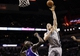 Dec 29, 2013; San Antonio, TX, USA; San Antonio Spurs forward Aron Baynes (16) takes a shot over Sacramento Kings forward Quincy Acy (bottom) during the first half at the AT&T Center. Mandatory Credit: Soobum Im-USA TODAY Sports
