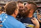 Dec 29, 2013; San Diego, CA, USA; San Diego Chargers quarterback Philip Rivers (17) and safety Eric Weddle (32) celebrate the Chargers 27-24 overtime win over the Kansas City Chiefs at Qualcomm Stadium. Mandatory Credit: Stan Liu-USA TODAY Sports