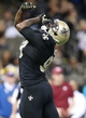Dec 29, 2013; New Orleans, LA, USA; New Orleans Saints outside linebacker Junior Galette (93) celebrates a sack against the Tampa Bay Buccaneers in the second half at the Mercedes-Benz Superdome. New Orleans defeated Tampa Bay 42-17. Mandatory Credit: Crystal LoGiudice-USA TODAY Sports