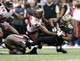 Dec 29, 2013; New Orleans, LA, USA; New Orleans Saints running back Khiry Robinson (29) is tackled by Tampa Bay Buccaneers free safety Dashon Goldson (38) in the second half at the Mercedes-Benz Superdome. New Orleans defeated Tampa Bay 42-17. Mandatory Credit: Crystal LoGiudice-USA TODAY Sports