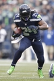 Dec 29, 2013; Seattle, WA, USA; Seattle Seahawks running back Marshawn Lynch (24) runs with the ball against the St. Louis Rams during the third quarter at CenturyLink Field. Mandatory Credit: Joe Nicholson-USA TODAY Sports