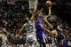 Dec 29, 2013; San Antonio, TX, USA; Sacramento Kings forward Rudy Gay (8) puts up a shot over San Antonio Spurs forward Boris Diaw (33) during the second half at the AT&T Center. The Spurs won 112-104. Mandatory Credit: Soobum Im-USA TODAY Sports