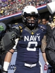 Dec 30, 2013; Fort Worth, TX, USA; Navy Midshipmen safety Wave Ryder (8) leaves the field after being ejected for targeting in the game against the Middle Tennessee Blue Raiders at Amon G. Carter Stadium. Mandatory Credit: Tim Heitman-USA TODAY Sports