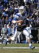 Dec 30, 2013; Fort Worth, TX, USA; Middle Tennessee Blue Raiders quarterback Logan Kilgore (10) rolls out to pass against the Navy Midshipmen in the first quarter at Amon G. Carter Stadium. Mandatory Credit: Tim Heitman-USA TODAY Sports