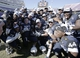 Dec 30, 2013; Fort Worth, TX, USA; Navy Midshipmen pose with the trophy after the game against the Middle Tennessee Blue Raiders  at Amon G. Carter Stadium.  Navy beat Middle Tennessee 24-6. Mandatory Credit: Tim Heitman-USA TODAY Sports