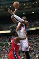 Dec 30, 2013; Auburn Hills, MI, USA; Detroit Pistons center Andre Drummond (0) shoots over Washington Wizards power forward Trevor Booker (35) during the first quarter at The Palace of Auburn Hills. Mandatory Credit: Tim Fuller-USA TODAY Sports