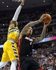 Dec 30, 2013; Denver, CO, USA; Miami Heat small forward Michael Beasley (8) takes a shot against Denver Nuggets point guard Randy Foye (4) in the fourth quarter at the Pepsi Center. The Heat defeated the Nuggets 97-94. Mandatory Credit: Isaiah J. Downing-USA TODAY Sports
