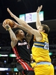 Dec 30, 2013; Denver, CO, USA; Denver Nuggets center Timofey Mozgov (25) defends against Miami Heat small forward Michael Beasley (8) in the third quarter at the Pepsi Center. The Heat defeated the Nuggets 97-94. Mandatory Credit: Isaiah J. Downing-USA TODAY Sports