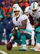 Dec 22, 2013; Orchard Park, NY, USA; Miami Dolphins center Mike Pouncey (51) waits to snap the ball against the Buffalo Bills at Ralph Wilson Stadium. Buffalo beats Miami 19 to 0.  Mandatory Credit: Timothy T. Ludwig-USA TODAY Sports