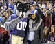 Dec 27, 2013; San Francisco, CA, USA; Washington Huskies mascot Harry (left) poses with fan Kymber Payne at the 2013 Fight Hunger Bowl at AT&T Park. Mandatory Credit: Kirby Lee-USA TODAY Sports