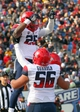 Dec 31, 2013; Shreveport, LA, USA; Arizona Wildcats running back Ka'Deem Carey (25) is lifted up by a teammate after scoring a  touchdown in the third quarter against the Boston College Eagles at Independence Stadium. Arizona defeated Boston College 42-19. Mandatory Credit: Crystal LoGiudice-USA TODAY Sports