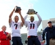 Dec 31, 2013; Shreveport, LA, USA; Arizona Wildcats quarterback B.J. Denker (7) and safety William Parks (11) hold up the offensive player of the game and defensive player of the game trophies at Independence Stadium. Arizona defeated the Boston College Eagles 42-19. Mandatory Credit: Crystal LoGiudice-USA TODAY Sports