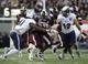 Dec 31, 2013; Memphis, TN, USA; Rice Owls linebacker Alex Lyons (41) tackles Mississippi State Bulldogs running back LaDarius Perkins (27) during the second quarter at Liberty Bowl Memorial Stadium. Mandatory Credit: Justin Ford-USA TODAY Sports