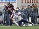 Dec 31, 2013; Memphis, TN, USA; Mississippi State Bulldogs wide receiver Jameon Lewis (4) is brought down by Rice Owls safety Julius White (7) at Liberty Bowl Memorial Stadium. Mandatory Credit: Justin Ford-USA TODAY Sports