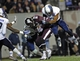 Dec 31, 2013; Memphis, TN, USA; Rice Owls safety Julius White (7) tackles Mississippi State Bulldogs wide receiver De'Runnya Wilson (81) during the second half at Liberty Bowl Memorial Stadium. Mississippi State Bulldogs beat Rice Owls 44 - 7. Mandatory Credit: Justin Ford-USA TODAY Sports