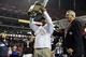 Dec 31, 2013; Atlanta, GA, USA;  Texas A&M Aggies head coach Kevin Sumlin clebarets with the trophy after defeating the Duke Blue Devils 52-48 in the 2013 Chick-fil-a Bowl at the Georgia Dome. Mandatory Credit: Dale Zanine-USA TODAY Sports