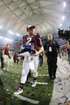 Dec 31, 2013; Atlanta, GA, USA; Texas A&M Aggies quarterback Johnny Manziel (2) walks off the field with the Offensive MVP trophy after defeating the Duke Blue Devils during the 2013 Chick-fil-A Bowl at the Georgia Dome. Texas A&M won 52-48. Mandatory Credit: Paul Abell-USA TODAY Sports