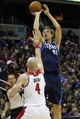 Jan 1, 2014; Washington, DC, USA;  Dallas Mavericks power forward Dirk Nowitzki (41) shoots the ball over Washington Wizards center Marcin Gortat (4) in the third quarter at Verizon Center. The Mavericks won 87-78. Mandatory Credit: Geoff Burke-USA TODAY Sports