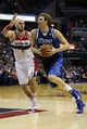 Jan 1, 2014; Washington, DC, USA;  Dallas Mavericks power forward Dirk Nowitzki (41) dribbles the ball past Washington Wizards center Marcin Gortat (4) in the third quarter at Verizon Center. The Mavericks won 87-78. Mandatory Credit: Geoff Burke-USA TODAY Sports
