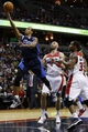 Jan 1, 2014; Washington, DC, USA;  Dallas Mavericks shooting guard Monta Ellis (11) shoots the ball past Washington Wizards center Marcin Gortat (4) and power forward Trevor Booker (35) in the fourth quarter at Verizon Center. The Mavericks won 87-78. Mandatory Credit: Geoff Burke-USA TODAY Sports
