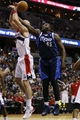Jan 1, 2014; Washington, DC, USA;  Washington Wizards center Marcin Gortat (4) is fouled by Dallas Mavericks center DeJuan Blair (45) while shooting the ball in the third quarter at Verizon Center. The Mavericks won 87-78. Mandatory Credit: Geoff Burke-USA TODAY Sports